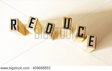 Reduce, Word Written On A Wooden Block. Reduce, Reuse And Recycle