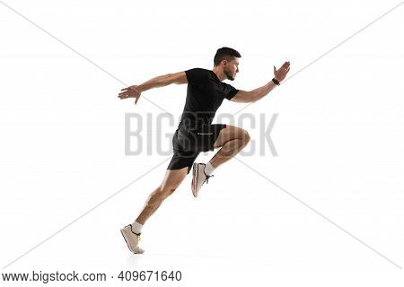 In Jump. Caucasian Professional Sportsman Training Isolated On White Studio Background. Muscular, Sp
