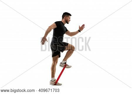 Stretching. Caucasian Professional Sportsman Training Isolated On White Studio Background. Muscular,