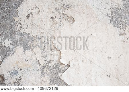 Old Wall Damaged With Blown Plaster And Paint Clog, Peeling Paint Damage, Water Damage On Building W