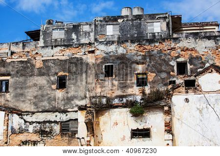 old ruined house with empty windows