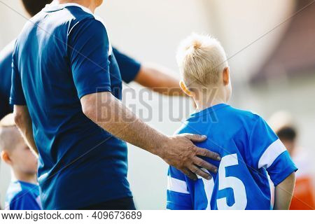 Sport Coach Supporting Young Player. Child Soccer Player Entering Game From Bench. Football Coach Tr