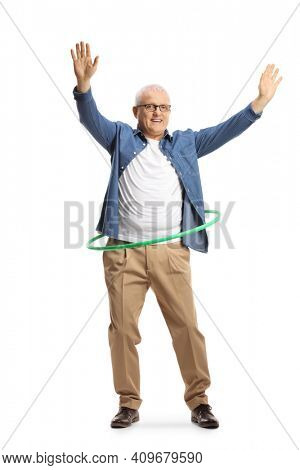Full length portrait of a cheerful mature man spinning a hula hoop isolated on white background