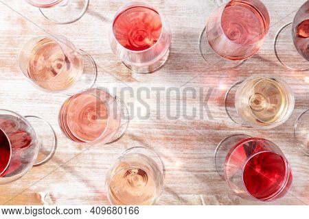 Wine Design Template. Various Glasses Of Wine Forming A Frame For Copy Space, Overhead Flat Lay Shot