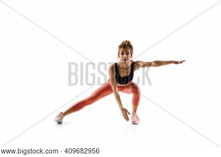 Squats. Young Caucasian Female Model In Action, Motion Isolated On White Background With Copyspace.