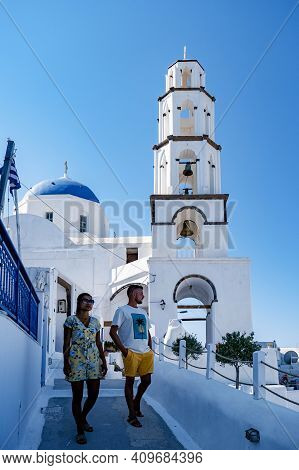 Pyrgos Village Santorini With Blue Domes And White Washed House During Sunset At The Island Of Santo