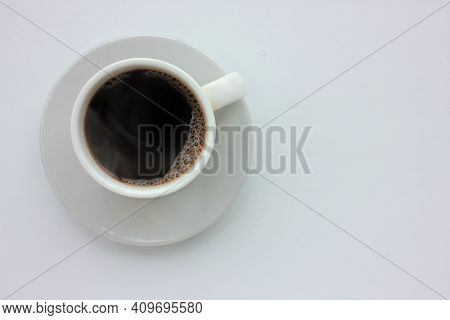 Cup Of Black Hot Espresso Coffee With Steam On White Background. Top View, Copy Space. Morning Espre