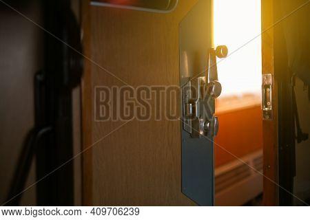 Sunlight Hits The Train Compartment Door And Metal Door Handle.