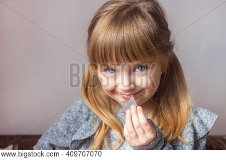 Little Girl With Chocolate In Hand Blurred Portrait Close-up, Childish Emotions Happy Childhood, Har