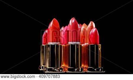 Variations Of Different Lipsticks Isolated On Black.