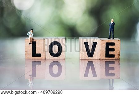 Miniature People : Couple Of Love With Love Text. Concept For Use In Love Relationship, Divorce Or C