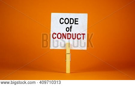 Code Of Conduct Symbol. White Paper With Words 'code Of Conduct', Clip On Wood Clothespin. Beautiful