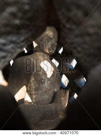 Buddha In Stupa Borobudurtemple. Indonesia.