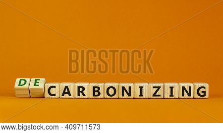 Carbonizing Or Decarbonizing Symbol. Turned Wooden Cubes And Changed Words 'carbonizing' To 'decarbo