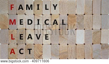 Fmla, Family Medical Leave Act Symbol. Concept Words Fmla, Family Medical Leave Act On Wooden Blocks