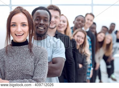 close-up . young woman standing in front of a group of young people