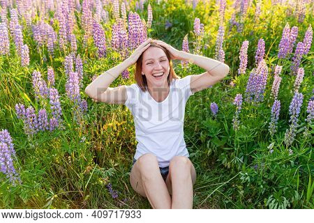 Happy Girl Smiling Outdoor. Beautiful Young Brunete Woman Resting On Summer Field With Blooming Wild