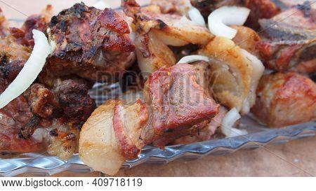 Caucasian Traditional Shaslik (shaslyk, Shish Kebab). Bonfire From Grapevine Twigs