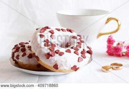 Styled Stock Photo. Donuts, Two Golden Rings, And A Cup Of Coffee On A White Table. Retro Style.conc