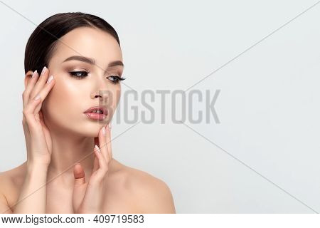 Portrait Of Young Beautiful Caucasian Woman Touching Her Face. Cleaning Skin, Spa Therapy, Skincare,