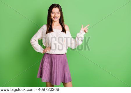 Photo Of Young Attractive Happy Positive Good Mood Girl Pointing Finger Copyspace Isolated On Green
