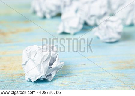 Many Balls Of Crumpled Paper On A Wooden Table. Search For Inspiration, Ideas. Search Difficulties