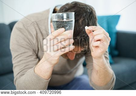 Man Fighting Stress With Antidepressant Drugs Meds