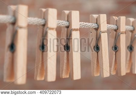 Wooden Clothespins On A Rope. Selective Focus On One Clothespin