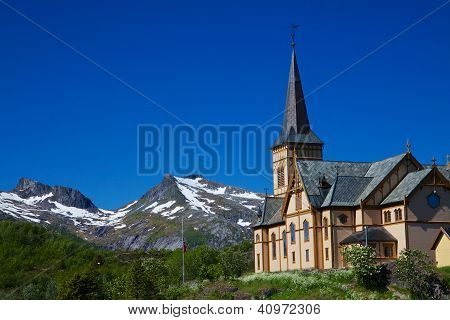 Scenic Lofoten cathedral famous landmark on Lofoten islands in Norway with snowy mountain peaks in the background poster