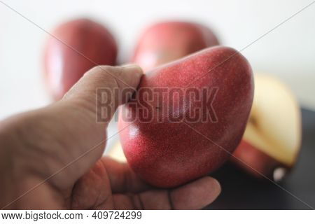 The Red Bartlett Pear Carries A True Pyriform Pear Shape. A Rounded Bell On The Bottom Half Of The F