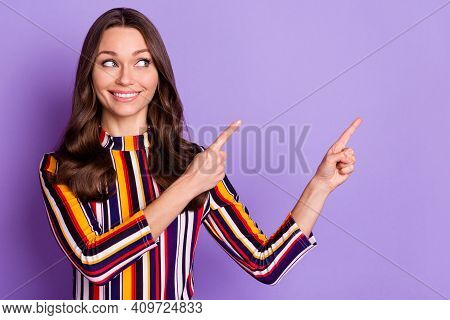 Photo Portrait Of Woman Pointing Fingers Looking Copyspace Curious Smiling Advising Isolated Bright