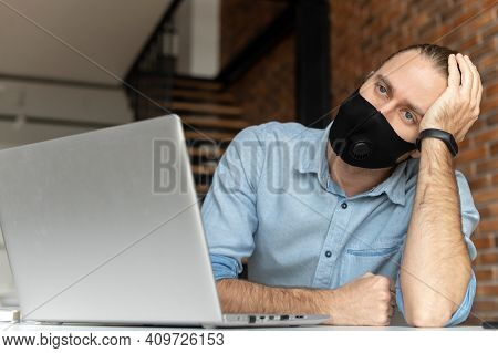 Disappointed Businessman In Black Mask, Holding The Head, Looking Away, Got To Know About The Bankru