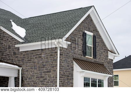 House Wall Faced With Natural Stone Tiles Block