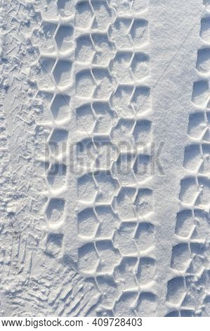 Car Wheel Tread Print On Snow. Wintertime