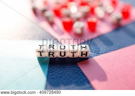 The Word Truth Is Assembled From Letters On White Cubes On A Multi-colored Background. Search For Tr