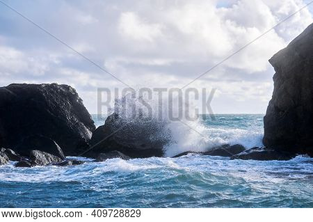 Stormy Surf With Splashes Among Coastal Rocks On The Shore Of The Winter Sea