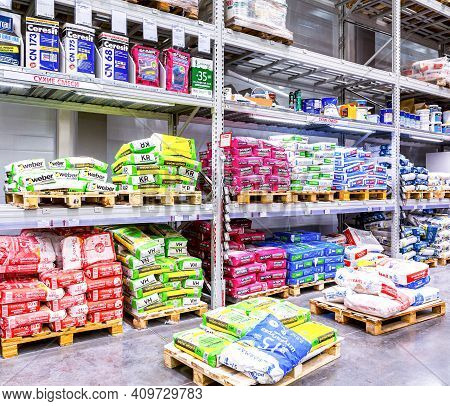 Samara, Russia - October 1, 2017: Sale Of Dry Building Mixes In A Construction Store. Various Cement