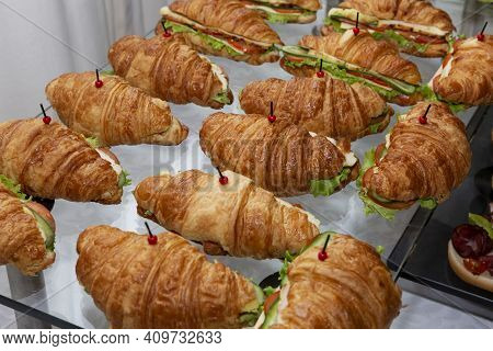 Croissant Sandwich On The Buffet Table. Catering For Business Meetings, Events And Celebrations. Clo