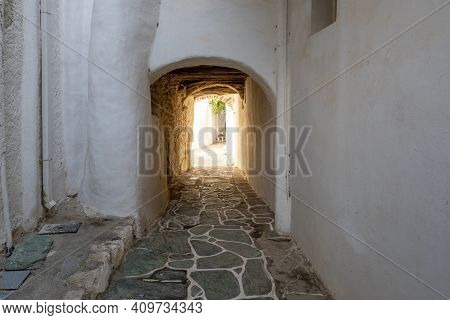 Narrow Street In Castro (kastro), The Oldest Part Of The Chora Town On Folegandros Island. Cyclades,