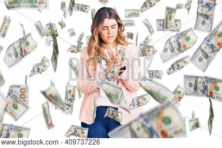 Young caucasian woman wearing business clothes suffering pain on hands and fingers, arthritis inflammation