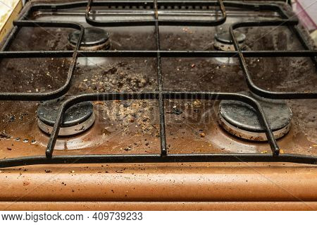 The Gas Stove Is Covered In Grease And Stains Of Dirt.unsanitary Conditions And Mess In The Kitchen.