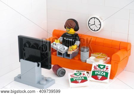 Tambov, Russian Federation - February 24, 2021 Lego Video Game Guy Minifigure Sitting On A Couch Pla