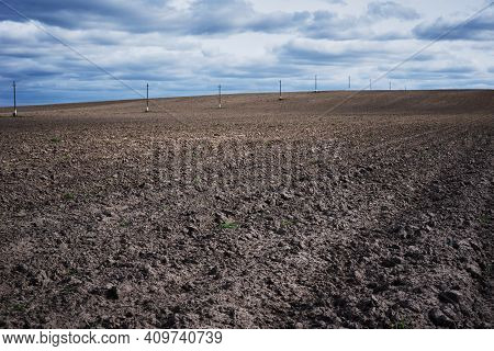 Plowed Field In Spring Day. Plowed Soil For Planting Crops