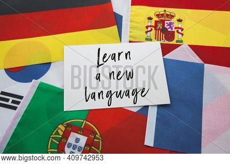 National Flags Of France, Porutgalia, Spain, Japan And Others And The Inscription Learn A New Langua
