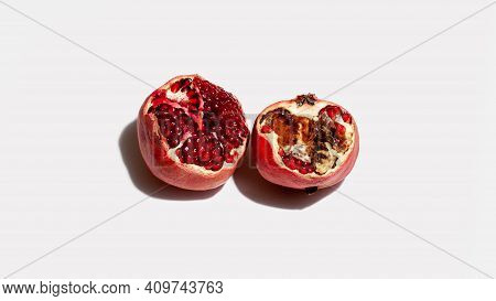 Ugly Bad Food Pomegranate On White Background. Food Waste Concept