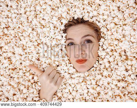 Girl Portrait In Popcorn. Image Of Beautiful European Woman 20S Eating Popcorn. Eating Popcorn. Youn