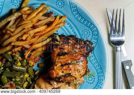 Honey Mustard Grilled Chicken Thigh Dinner Served With Home-made Shoestring French Fries And Vegetab