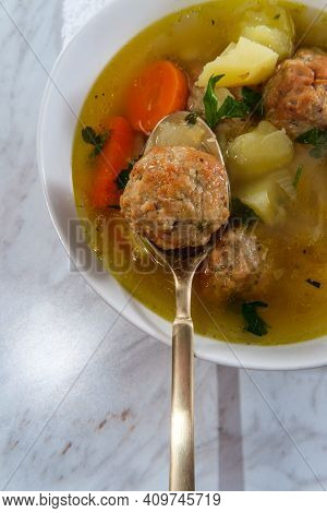 Russian Frikadeller Meatball Soup With Potatoes And Parsley Garnish