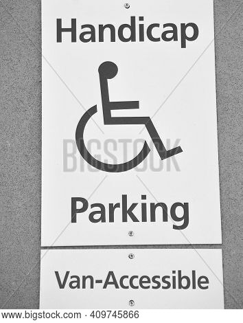 Handicap Parking Sign Displayed Outdoors For Drivers.
