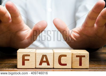 The Man Fences Himself Off With His Hands From The Word Fact. Denial And Non-acceptance Rejection Of